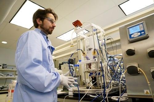 Scientist working with bioreactor